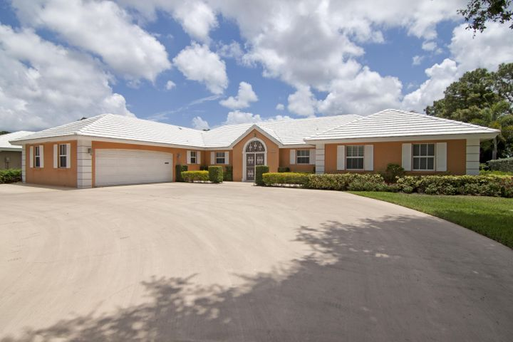 505 Muirfield Drive, Atlantis, FL 33462