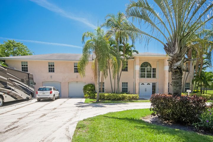 Nice circular drive entry and lots of additional parking plus 6 car garage