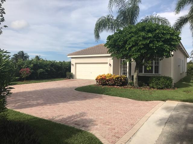 140 Palm Cir, Atlantis, FL 33462