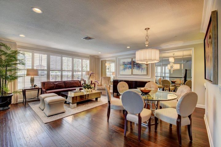 Luxurious Living Room with wood floors and California shutters