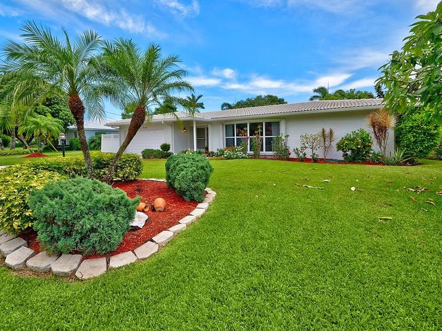 Beautifully Landscaped and Spacious Front Yard on Quiet Street.