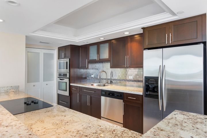 beautiful wood cabinetry, stainless steel appliances