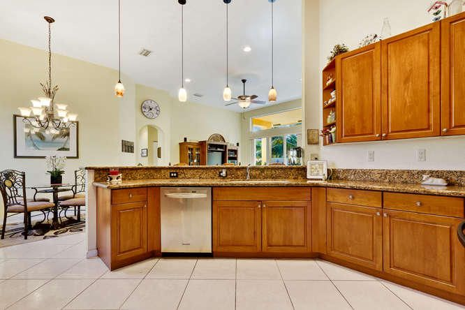 Large open kitchen features granite counters and Stainless Appliances