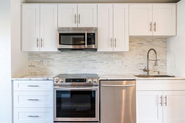 New counters, cabinets, floors, new stainless appliances!