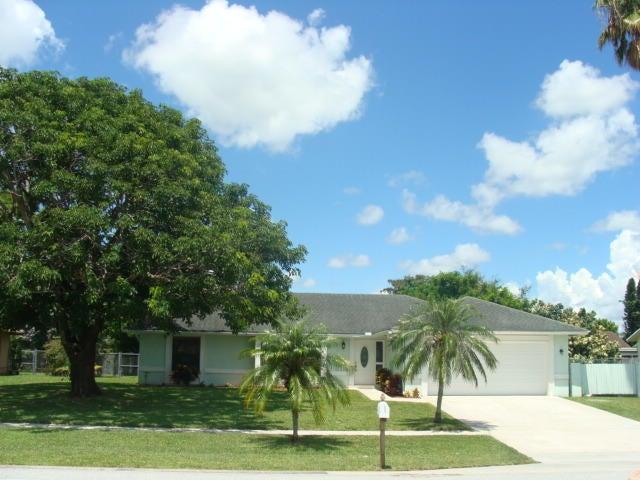 126 La Mancha Avenue, Royal Palm Beach, FL 33411
