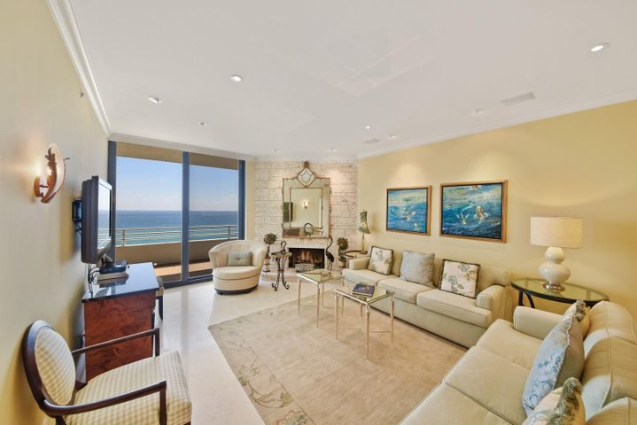 Gorgeous Ocean Views from Spacious Open Concept Living Area with Working Fireplace. All Impact Glass throughout