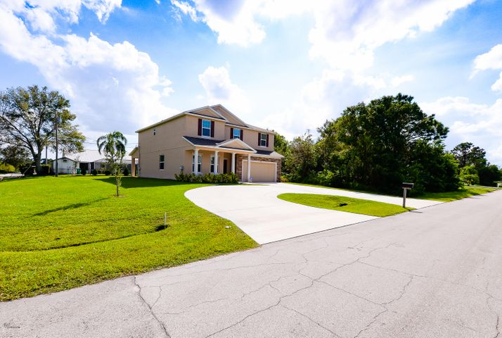 1002 SW Calmar Avenue, Port Saint Lucie, FL 34953