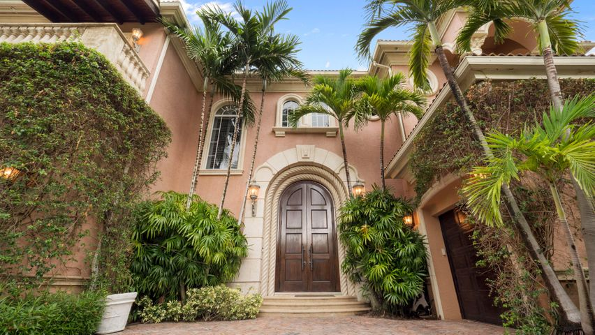 Spectacular waterfront estate home for sale in the esteemed Harbour Isles gated community of North Palm Beach.