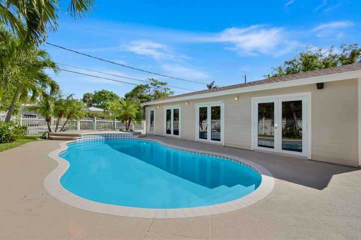 Free-form heated pool and guest house/pool room