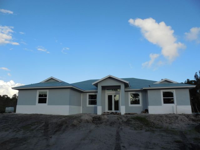 4/3/2 CBS Home with metal roof and Impact windows scheduled for delivery late December 2017.