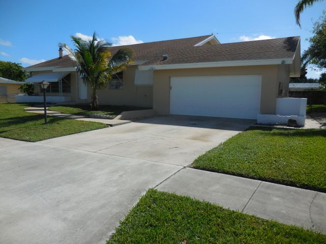 Lots of curb appeal, 2 car garage , large driveway