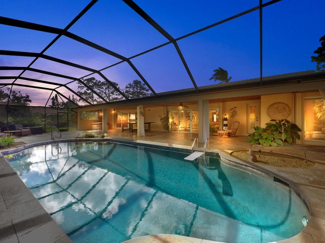 resort style pool with expansive covered patio and over head screening