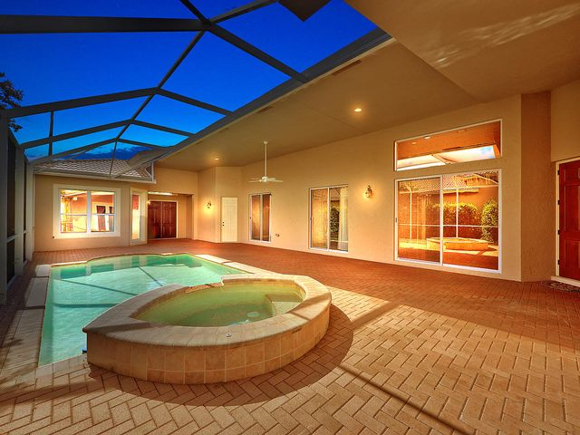 Spa and pool with expansive screened enclosure.