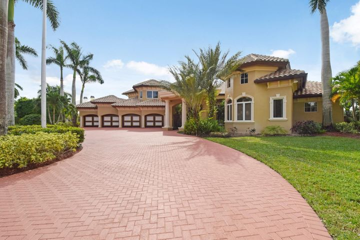 Circlular driveway. Covered Gate House entry. 4 car air conditioned garage. HUGE golf view lot. 5 bedroom suites. 6 full and 2 half baths. Office.