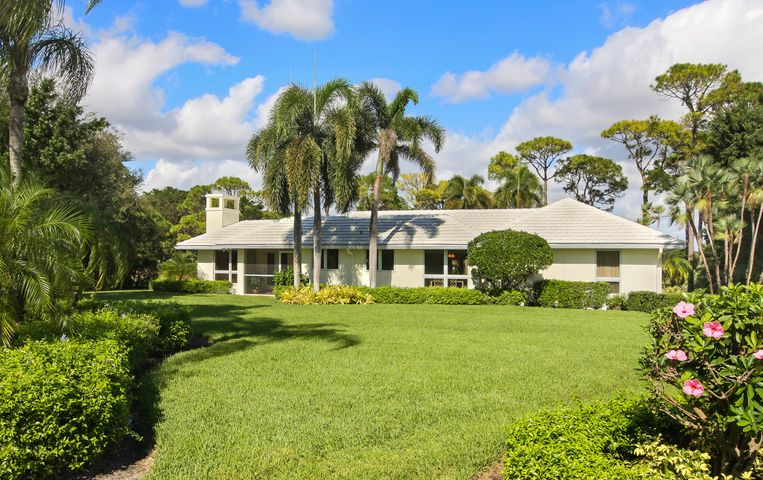 Elegantly sited on .69 of an acre with expansive golf course views