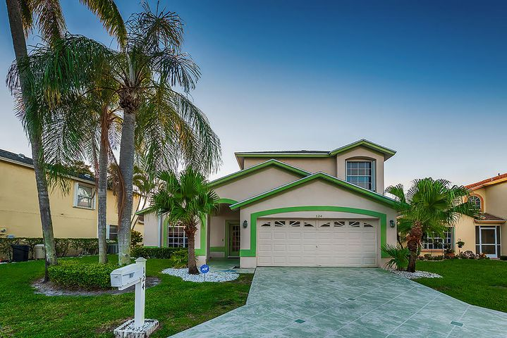 124 Hammocks Court, Greenacres, FL 33413