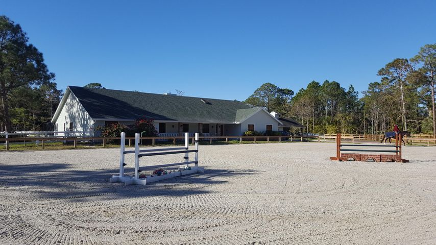 """Marvelous equestrian property with French cottage style large house and """"all weather"""" riding ring."""