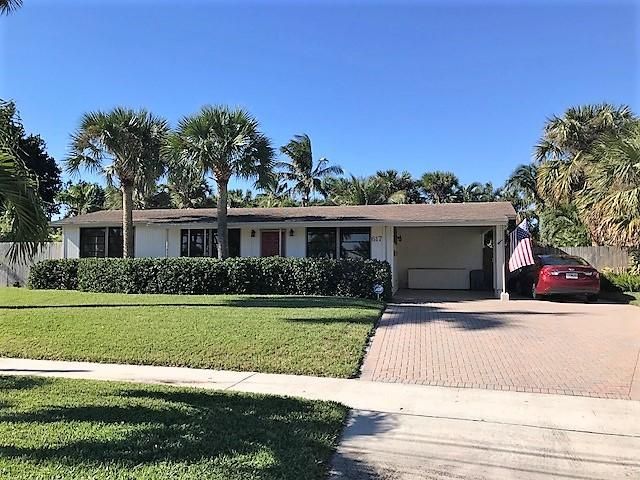 Meticulously cared for 3/2 in the coveted neighborhood of North Palm Beach.  This home features a split floor plan, with a spacious kitchen, adjacent dining area, and beautiful, bright sun room with all impact glass. Many new appliances. Situated on a slightly larger than 1/4 acre lot, the home boasts an over-sized swimming pool and beautifully landscaped back yard. It also has an indoor workshop, perfect for artists and hobbyists.  No better value in NPB!