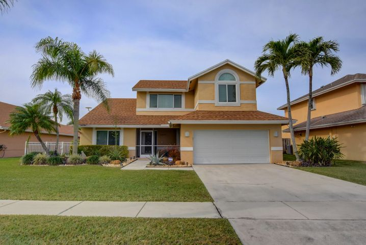Stunning  4 bedroom 2.5 bath home with Master bedroom downstairs.  Huge private screened pool, incredible cherry wood and granite Kitchen with SS appliances. Hurricane impact windows except sliders that have accordion. Lot has extended side yards went built. Mechanics dream  2 car garage.   Low HOA and 3 'A' rated schools less than two miles away. Ready to move in!!