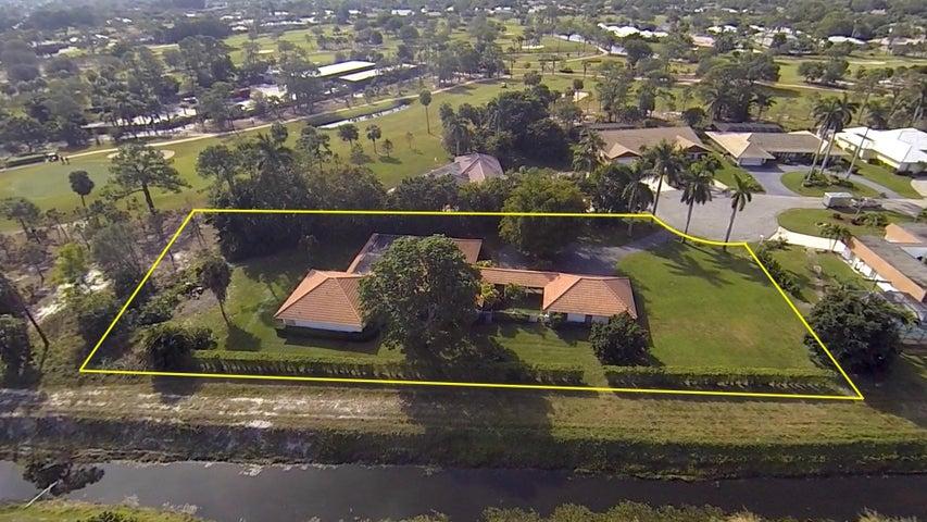 404 Muirfield Drive, Atlantis, FL 33462