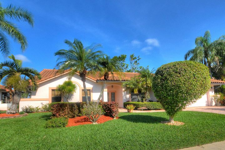 This is the property for you or your clients, 4 years old roof, new a/c, impact window all around, child barrier for the pool.  Upgraded kitchen, appliances and floors.  Unique floor plan,  large master suite with huge walk in closet.  On open golf lot.  This property is move in ready.Boca Greens is a gated community of almost 600 homes located one mile north of Glades road on US 441. This community is also the home of the Boca Greens County Club. All residents can play the course on a pay for play basis. No membership is required. But for those who do want a country club experience there are a number of non-equity memberships available. Premium cable package and high speed Internet included the homeowner fee.