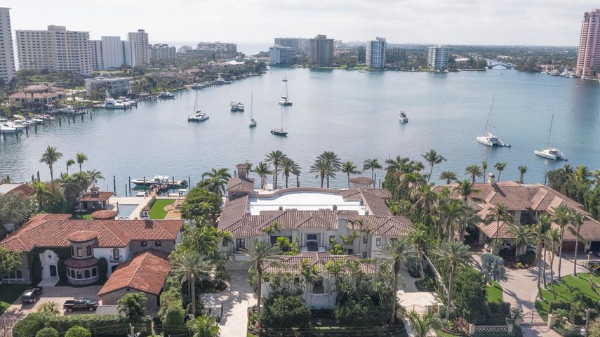 """One of Lake Boca Raton's best viewpoints is reserved for this imposing gated compound on 150+/- feet of shoreline, looking all the way down the water and surrounding coastline to the historic Boca Raton Resort & Club.  Unobtrusively placed to the side, the rare cut-in yacht slip is large enough for a 120+/--foot vessel and is close to the inlet.  Additional dockage can berth another 75+/--foot yacht.  Designed for large-scale gatherings, the sensational outdoor entertainment space centers on the 63+/--foot infinity pool and grand loggia with a summer kitchen/bar, cabana bath, and boat equipment storage.  Exotic Medjool date palms are signature elements of the lush tropical landscaping. DISCLAIMER: The written and verbal information provided including but not limited to prices, measurements, square footages, lot sizes, calculations and statistics have been obtained and conveyed from third parties such as the applicable Multiple Listing Service, public records as well as other sources. All information including that produced by the Sellers or Listing Company are subject to errors, omissions or changes without notice and should be independently verified by any prospect for the purchase of a Property.  The Sellers and Listing Company expressly disclaim any warranty or representation regarding all information.  Prospective purchasers' use of this or any written and verbal information is acknowledgement of this disclaimer and that Prospects shall perform their own due diligence.  Prospective purchasers shall not rely on any written or verbal information provided when entering a contract for sale and purchase.  Some affiliations may not be applicable to certain geographic areas. If your property is currently listed, please do not consider this a solicitation. In the event a Buyer defaults, no commission will be paid to either Broker on the Deposits retained by the Seller.  """"No Commissions Paid until Title Passes.""""  Copyright 2018 Listing Company. All Rights Reserved."""