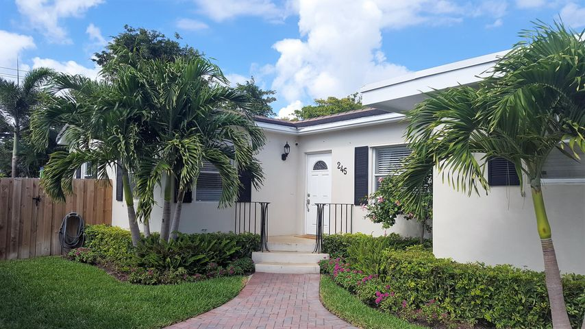 Located east of Olive Ave., in WPB's Southland Park and just a short walk to the Intracoastal Waterway, this spacious 2-bed/2-bath home has been well maintained and tastefully renovated inside and out.  Original wood flooring stretches throughout the home with wood-look tile in the master bedroom. The modern kitchen opens to a large dining/living room that overlooks the fenced in backyard. The property is surrounded by 8 foot ficus hedge and tropical foliage. Most recent renovations include A/C (2011), paver driveway & walkway (2012), complete new roof (2013), new irrigation, garage door and fence (2017).  Tropical landscaping, modern renovations, ideal location and a historic vibe!