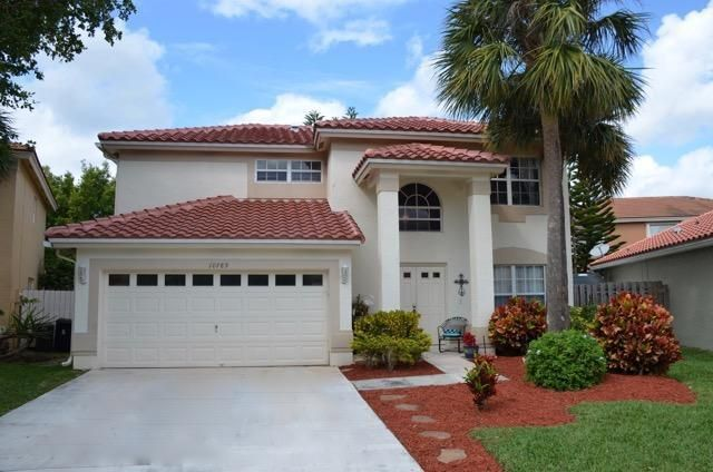 Pride of ownership shows in this beautiful 4 bedroom, 2 1/2 bath, 2 car garage home located in Boca Raton. This 2 story home features all bedrooms upstairs as well as an additional area, great for a desk or work space. The master suite has a large walk in closet, and master bath has a Roman tub and separate shower. The downstairs has a spacious living area with a formal dining room, and large eat in kitchen overlooking the family room. There are new wood floors and the interior has been recently repainted. The A/C and appliances are newer and the roof is brand new.  Low HOA fee covers basic cable, lawn , and sprinklers. Community pool and tennis. Click on the virtual tour link above for walk through tour. This is a must see!