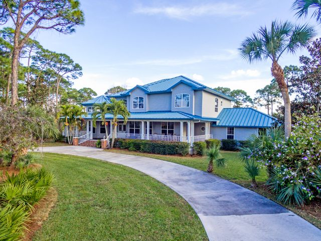 4+ ACRE WATERFRONT HOME! Entering the small unique gated enclave of 7 homes you are in an environmental preserve. A large wrap around porch invites you to pause and take in the peacefulness that is Charleston Oaks. Entering the home you are greeted by soaring ceiling, traditional staircase and natural light coming from the many windows.  Features a large country kitchen with a causal breakfast area, formal dining room, large master suite down and 3 bedrms, 2 full baths and a loft up. The covered back porch leads out to the oversized screened pool and spa. There is a lit path down to the N. Fork of the St Lucie River through the Sanctuary. The dock and community pavilion are along the river.  Just outside the gate you are minutes to Publix,I95, hospitals, schools & Indian River State Colleg