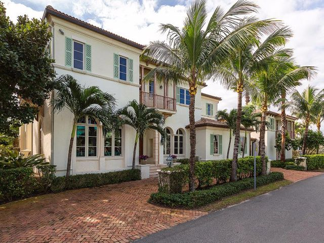 Live a one of a kind lifestyle in this magnificent estate home. Located across the street from the beach and just blocks from Delray's trendy Atlantic Avenue, this 7 bedroom, 8.5 bath home boasts over 10,000 total sq ft with stunning architectural details. Newly redesigned interior just completed.  Upon entry, the gorgeous arched hallway leads to a formal dining room, the elegant living room with stone fireplace and floor to ceiling windows is also located in this wing. A sun-filled family room complete with wet bar and breakfast room flows into the expansive kitchen featuring gas cook top, double ovens, dual sinks and stainless appliances. Double French doors in both family room and kitchen lead to a grand loggia with fireplace, and summer kitchen, all overlooking the pool and garden Continuing to the second floor is the sumptuous master suite with French doors opening to your private terrace and fireplace.  This tranquil retreat is highlighted by his and her baths, walk-in dressing rooms and vaulted ceilings. A charming living space with peek-a-boo ocean views is perched above the third level. There are 2 full laundry rooms for your convenience and a full butler's pantry. Additional features include a separate guest house, expansive home theatre room, formal office, temperature controlled wine cellar, large outside loggias, cabana bath, elevator and exquisite architectural details abound throughout.