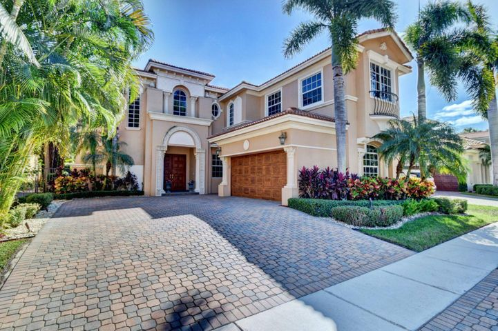Impeccably maintained, this exquisite home is located within the prestigious Mizner Country Club community. This enhanced model includes 4 bedrooms (Master on first floor) and 5 bathrooms, under 4020 of A/C SqFt. Outstanding attention to detail. Custom painting, lighting and speaker system. Built in closet system and safe. Beautiful wood flooring throughout living area. Glass top cook range and double wall oven. Open floor plan makes entertaining a pleasure.The backyard features a heated pool with spillover spa, covered patio area with summer kitchen set in lush tropical landscaping. Enjoy the ease of Social Membership at club.