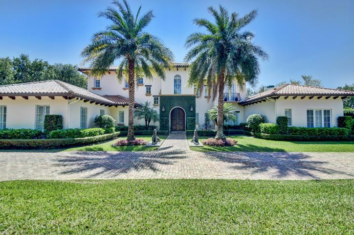 """Palm Beach Inspired Estate presents a Timeless Impression and is sited on over One Acre in Central Boca. Fronted by Wrought Iron Gates and an Impressive Chicago Brick Motor Court, this Exquisite Residence is surrounded by Meticulous Landscaping affording Great Privacy. Fully Equipped w/ Impact Windows & Doors, a Full House Generator and Extraordinary Outdoor Amenities including a professional grade Tennis Court w/lights, Oversized Gas Fire Pit w/ Built-In Seating, a Massive Summer Kitchen fit for a King, an Oversized Pool and Ample Covered Loggias. The Backyard faces south & seizes the  """"Southern Sun"""" providing the brightest sun exposure all day!  Two Guest Bedrooms Ensuite on the Main Level and the Master Bedroom Suite plus three additional ensuite bedrooms are upstairs. Add'l remarks. Palm Beach Inspired Estate presents a Timeless and Classically Stunning Impression and is sited on over One Acre in Central Boca Raton. Fronted by a Gated and Impressive Chicago Brick Motor Court, this Exquisite Residence is surrounded by Meticulous Landscaping affording Great Privacy, and is Fully Equipped w/ Impact Windows & Doors and a Full House Generator.  Extraordinary Outdoor Amenities offer an Unsurpassed Stage for Daily Living and Elegant Entertaining with a professional grade Tennis Court with lights, Oversized Gas Firepit with Built-in Seating, a Massive Summer Kitchen fit for a King, an Oversized Pool and Ample Covered Loggias and enjoy an outdoor space that rivals any 5-Star Resort!  Two Guest Bedrooms Ensuite on the Main Level and the Master Bedroom Suite plus three additional ensuite bedrooms are upstairs.  Open Kitchen features a gas stovetop, double ovens, double dishwashers an oversized island and breakfast area that are all open to a warm and relaxing Family Room with French Doors to the Outdoor Living Space. A Generously Sized Downstairs Recreation Room and an Authentically-Designed Gym/Exercise Room complete this offering."""