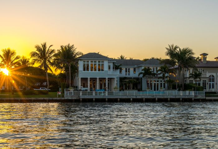 Spectacular, direct intracoastal, British West Indies inspired home by Bloomfield Builders.  Lushly landscaped estate with exceptional finishes and details throughout. Features include: transitional decor by decorators unlimited, club room, theater, beautiful multi level infinity pool, great summer kitchen, wine room, garage with 4 bays including lifts to accommodate 6 vehicles, there is also a seperate golf cart bay and incredible views from every room.