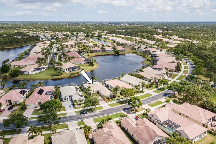 Lake Charles is conveniently located between I-95 and the FL Turnpike, gated with community heated pool, tennis, basketball, new club house and much more. Awaiting is your 3-bed, 3-bath, 3-car garage lake front pool home with 12' ceilings, 2,347 sqft under air & 4,020 total square feet.  This home is Florida living at its finest with the large kitchen overlooking the family, breakfast and formal dining areas.  The expansive master suite has his/her closets leading to the en-suite bath with separate water closet, bathtub, shower and his/her sinks. Bedroom two is spacious with walk in closet and en-suite bath, and bedroom three is large with an adjoining full bath.  Your home is complete with a 700 sq.ft screened pool and patio with beautiful lake views. Home Warranty included by AHS!