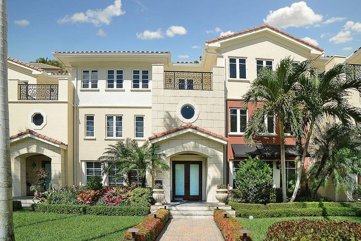 Located steps away from famed Atlantic Avenue and the Palm Beaches, this estate townhome is in the sought after community of Delray Beach. Nothing short of exquisite, this contemporary home boasts just under 6,000 square feet of living space with 4 bedrooms, 5 bathrooms,  2 powder rooms, media room and an additional bonus room. Other features include a private elevator, private 2 car garage, guest parking, a lusciously landscaped true courtyard style pool with fountains and your very own 4th-floor sky deck.From the moment you walk through the custom foyer, you will be wowed by the grand staircase, soaring high ceilings and be welcomed by your private pool views. The formal dining, living room and upstairs feature a gorgeous historic wood flooring. This 4-story estate offers an open-layout featuring a true chef's kitchen with recessed lighting, extended 42' wood cabinets, double-ovens, cooktop, stunning granite counter tops, and is equipped with a large food prep area with a custom hood. Perfect for entertaining, the breakfast and family rooms are just steps away from the sliding glass doors which lead to the tiled pool area and courtyard. Plenty of natural light streams through the impact glass windows and doors. As you enter the upstairs area, you'll immediately appreciate the beautiful flow created by the elegant wood floors. The gorgeous master suite is equipped with large custom-built walk-in/closets, separate his and her master bathrooms with joint access to a large shower.  A balcony overlooks a protected preserve.   Additional notable features include gorgeous marble flooring, crown moldings, custom lighting, designer window treatments and a full house SONOS speaker system. The home is also assigned to great A plus rated schools. Please make sure to take a look at the 3D Tour / Virtual Walk-Thru of the home!