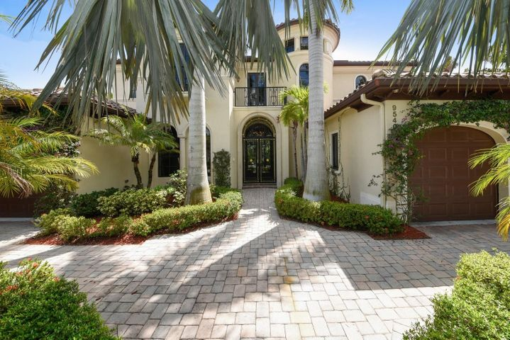 This Beautiful two story Balmonte Grande III Estate home located in the Prestigious gated community The Oaks at Boca Raton. State of the art kitchen featuring top of the line appliances, granite counters, cherry cabinets. Designer Mahogany built in Wall Units in Family rm, Master Bdrm suite (1st level), Library and Media Rm. Impressive Custom Wrought Iron Gate at front door entrance, Beautiful Exotic Wood Floors and Polished Saturnia Marble. Gorgeous Palm Beach Style Pool area with Lush Landscape enhancements. Fabulous Viking State of the art outdoor Grill area. Cabana bath convenient to pool area with Italian statues and urns creating a European ambiance with California style Hurricane impact glass double doors that open onto Veranda.