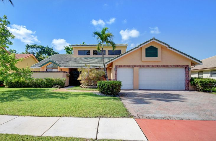 LIGHT AND BRIGHT OPEN FLOOR PLAN, BOCA GREENS 4 BEDROOM 3.5 BATH HOME WITH 2.5 GARAGE SPACES. MODEL ON A CUL DE SAC STREET. OPEN FLOOR PLAN HAS A LARGE MASTER SUITE WITH WALK IN CLOSETS AND A BATH SUITE THAT FEATURES SEPARATE VANITIES, A BIDET WALK IN SHOWER AND TUB. THE CABANA BATH CAN BE USED A SECOND BATH TO THE MASTER SUITE. ALL FLOORS ARE TILED AND THERE IS NOT CARPET IN THE HOUSE. BEDROOMS TWO AND THREE HAVE A JACK AND JILL BATH. BOTH BEDROOMS HAVE AMPLE CLOSET SPACE. BEDROOM 4 BAN BE USED AS AN OFFICE OR SITTING ROOM AND HAS A CLOSET. HALF BATH IS OFF OF THE LIVING AREA AND FEATURE WAINSCOTING. THE DOUBLE DOOR ENTRY LEADS TO A FOYER AND INTO THE LARGE FORMAL LIVING DINING ROOM WITH SOARING CEILINGS AND IS LIGHT AND BRIGHT. THE EAT IN KITCHEN HAS GRANITE COUNTERS AND LOTS OF STORAGE SPACE AND OVERLOOKS THE POOL AND PATIO AREA.   AMAZING SCREENED IN POOL AND PATIO FEATURES A SEPARATE JACUZZI OVER LOOKING THE BOCA GREENS GC. BOCA GREENS IS A GUARD GATED COMMUNITY AND FEATURES LOW HOA FEES AND NO COUNTRY CLUB MEMBERSHIP OR EQUITY REQUIRED. GOLF AVAILABLE PAY TO PLAY. FOR MORE INFORMATION VISIT  https://www.bocagreenscountryclub.com/