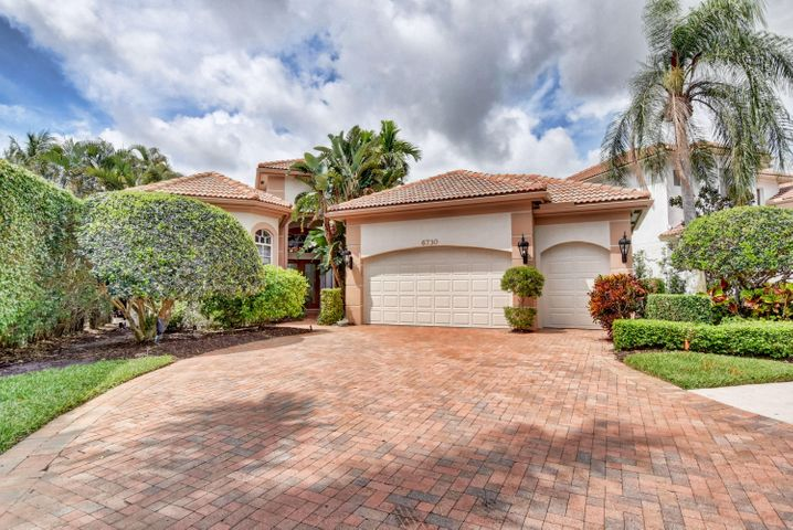 This fabulous home has 3 Bdrms, 3.5 baths.  Features include all marble flooring & carpet in the bedrooms, crown molding thru-out.  As you walk thru the double glass entry doors, you enter into your open living/Dining room with incredible finishes, from fixtures to window treatments.  As you enter your over sized kitchen w/all wood cabinets and all pull out drawers, you are part of your family room with great views of your free form pool & spa.  Your 3 way split floor plan includes your master suite with 2 large custom fitted closets and your over sized master bedroom; add to that your master bath is all marble with separate jaccuzi tub & separate shower.  His/her sinks, make up area tastefully decorated.  See supplement Your other two rooms are on either side of the house.  Owner uses one as his office/bedroom.  The home has a 2.5 car garage with a private garage for the golf cart.  The home features a golf membership.  Call me for your personal viewing of this great home