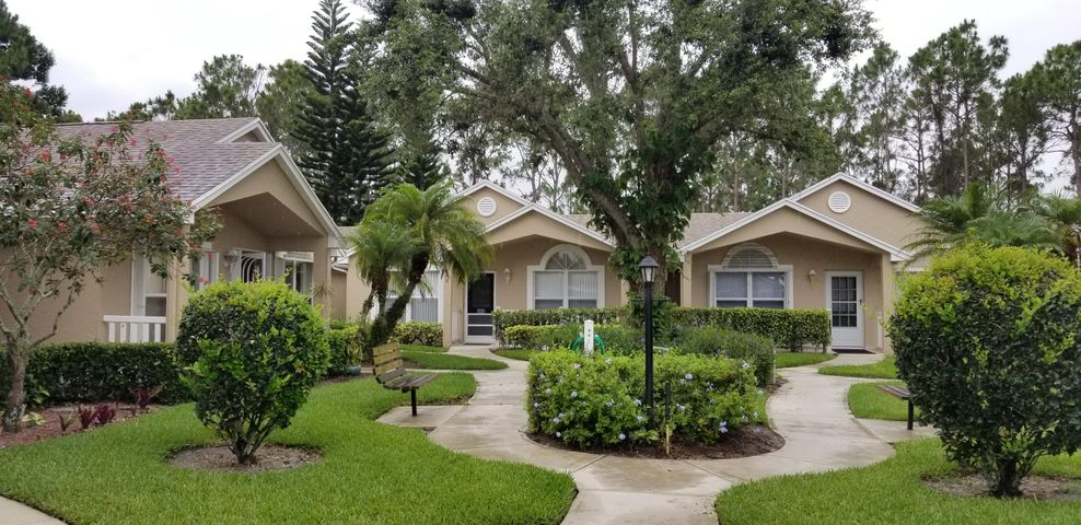 Beautiful Hibiscus model 2/2 with tiled & screened porch.Newly painted interrior , accordian & panel hurricane shutters,and all appliances stay.