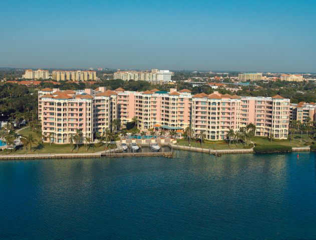 BREATHTAKING panoramic views of the Intracoastal, Lake Boca Raton, and the ocean beyond!  Wraparound corner condo with covered balcony accessible from every room, with over 500 sq. ft. of entertainment area, and full set of storm shutters.  Open kitchen with breakfast bar and separate breakfast room offering beautiful views to the grounds of the Boca Resort and city vistas. Great 3 BR/4 1/2 bath floor plan, including a separate laundry room and 4 fitted walk-in closets.  Nine ft. ceilings accent this special offering with custom marble flooring, cabinetry, upgraded lighting, and more!Enjoy the finest lifestyle available in downtown Boca, with this outstanding full service condo; 24 hour security, pool attendant, concierge, valet parking, 2 tennis courts, fitness rooms, pool, spa & more