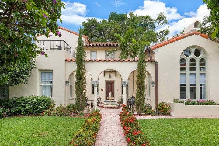 Straight from a magazine! Renovated to be the most charming home you've ever seen. It's even been rented out as a wedding venue! Historic 1926 ''Bankers Row'' VIlla designed by renowned Architect Samuel Ogren. Villa Abrigo (House of Comfort) offers a full Addison Mizner experience with elaborate columns, arched openings, pecky cypress wood beamed ceilings, ceramic-tile roofs and outdoor loggias. Main house is 4BR/2BA plus a 1BR/1BA detached cottage with kitchen. Private grounds provide a tranquil setting showcasing a brick-paved courtyard, loggia and fountain. A rare opportunity within in walking distance to all of downtown Delray Beach's charming shops and award winning restaurants. Picture perfect vacation home - only 3 blocks to Atlantic Ave; 1 mi to the beach!
