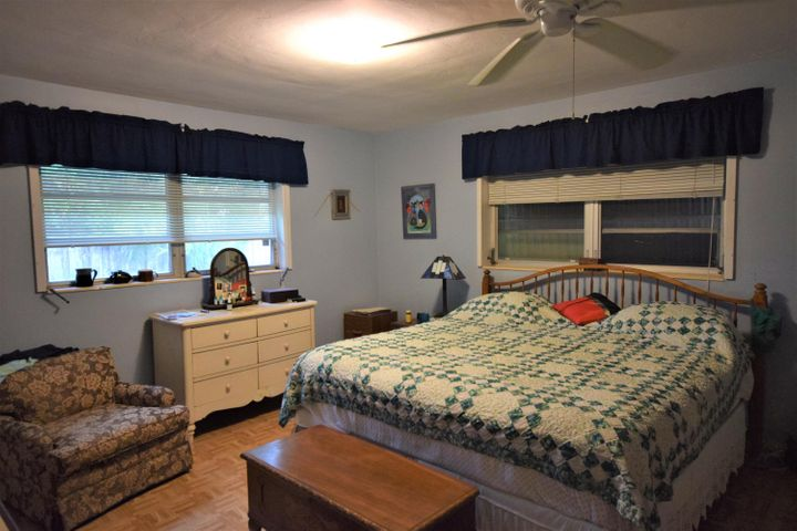 Charming 2 bedroom 2 bath home in the heart of Lake Ida, situated on a desirable .29 acre, 90x141 ft lot. This home boasts over 2000 total sq feet spacious sunny Florida room, formal dining room, and two car garage. Lushly landscaped private backyard with plenty of green space and mature trees. Just blocks to the beach and Atlantic Avenue and close to I95 and beaches. Lake Ida is a walkable neighborhood with public parks, boat launch, and Delray Beach Playhouse just blocks away.