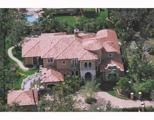 Custom built in 2005, this totally gated residence boast over 7000 square feet a/c on appx. .57 acre lot. Top of the line appointments including a back-up generator, oversize heated pool & spa, oversize 3 car garage, jerusalem stone floors downstairs Magnificent 2-story East Delray Custom built residence just minutes away from Atlantic Ave and 1 mile from the beach. This custom home was impeccably designed and includes every upgrade imaginable. 1st floor master suite has separate his/her baths and closets. An addl guest bedrm is also located off the fam rm on main floor. Custom built-ins accent the oversized 1st floor office and family room. Mahogany front doors accented beautifully with metal insets highlight the elegant sweeping marble staircase wit... (see supplement for full remars) Custom built in 2005, this totally gated residence boast over 7000 square feet a/c on appx. 2/3 acre lot. Top of the line appointments including a back-up generator, oversize heated pool & spa, oversize 3 car garage, jerusalem stone floors downstairs Magnificent 2-story east Delray Custom built residence just minutes away from Atlantic Ave. and 1 mile from the beach. This custom home was impeccably designed and includes every upgrade imaginable. 1st floor master suite has separate his/her baths and closets. An addl guest bedrm is also located off the fam rm on main floor. Custom built-ins accent the oversized 1st floor office and family room. Mahogany front doors accented beautifully with metal insets highlight the elegant sweeping marble staircase wit... (see supplement for full remarks)  Custom built-ins accent the oversized 1st floor office and family room. Mahogany front doors accented beautifully with metal insets highlight the elegant sweeping marble staircase with iron/wood banister. The formal living rm w/ firepl overlooks the custom designed pool and spa. A beautiful dining room is situated across from a walk in wine closet/butler pantry. Top of the line Kit. includes oversi