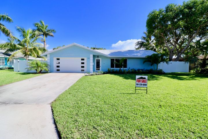 See Video Tour Link!  Like New Construction in Delray's Premier Neighborhood.  High end designer finishes throughout this open split floor plan with just over 1600 sf under air.  3 bedrooms, 2 bathrooms, 2 car garage, on a large manicured lot just minutes from downtown Delray Beach and a bike ride away from the beach.  Amazing open kitchen with huge quartz waterfall style island, high end KitchenAid appliances, and custom cabinetry.  Large master bedroom with frameless glass shower and walk in closet with built ins.  Large laundry room with custom cabinetry, sink, and high end washer/dryer.  Metal roof and impact windows and doors.  Large porcelain wood look tile throughout, LED high hat lights, smart home features for door bell, thermostat, water heater, and sprinkler system.  3 parks within the neighborhood, boat ramp to Lake Ida, playgrounds,  jogging paths.  This is where you want to live to experience the luxury Delray Beach lifestyle with a hint of small beach town feel!!