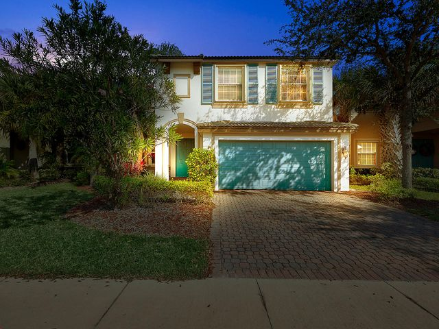5/2.5/ 2 car garage CBS home in TownPark at Tradition. Desirable Berkeley 5 model. Open floor plan integrates living, dining, family room and kitchen. Covered porch w/ extended screened patio overlooking a natural reserve. Laminate flooring and ceramic tile floors. Upgraded kitchen with NEW stainless steel appliances (refrigerator, microwave, range). New hot water heater. New AC in Dec 2015. Upgraded backsplash and $6,000 Quartz counter tops. Accordion shutters on 2nd level. This home is move-in ready. Walking distance to the resort style clubhouse and pool. Minutes from Tradition Square shops, restaurants, new Martin Health Tradition Medical Center. Easy access to I-95. Tradition is a master planned community in the heart of Florida's Treasure Coast. Buy a home here and get a community