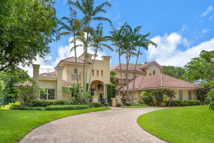 THIS MAGNIFICENT 9,674 SQ FT LAKEFRONT RESIDENCE WAS TAKEN DOWN TO SEVERAL CONCRETE WALLS, EXPANDED & TOTALLY REBUILT IN 2002, AND IS SITED ON A LUSHLY LANDSCAPED 1+/- ACRE WATERFRONT LOT W/ PRIVATE DOCK IN BOCA RATONS EASTERN MOST ACREAGE COMMUNITY, FIELDBROOK ESTATES. LARGE IMPACT WINDOWS THROUGHOUT FILL THIS BEAUTIFUL HOME WITH NATURAL LIGHT & OFFER SPECTACULAR VIEWS! THE DRAMACTIC DOUBLE DOOR ENTRY OPENS TO THE ABSOLUTELY GORGEOUS LIVING & DINING ROOMS W/ SPECTACULAR MILL WORK, FLAWLESS LIMESTONE FLOORING & EXPANSIVE VIEWS OF THE POOL W/ FOUNTAIN & LAKE. THE LARGE CHEF'S KITCHEN W/ SUBZERO, WOLF & MIELE APPLIANCES OPENS TO A LARGE BEAUTIFULLY FINISHED FAMILY ROOM. THE HUGE PLAY ROOM IS PERFECT FOR FAMILY! THE BEAUTIFUL LIBRARY/OFFICE HAS A PRIVATE ENTRANCE. THE AMAZING MASTER SUITE IS A SUMPTUOUS SANCTUARY WITH  OVERSIZED WINDOWS OFFERING EXPANSIVE VIEWS OF THE GROUNDS & LAKE AND OFFERS A PRIVATE GYM/YOGA STUDIO, PRIVATE DECK OVERLOOKING THE POOL & LAKE, PRIVATE DRESSING AREA, COFFEE BAR & LUXURIOUS MASTER BATH. THE POOL AREA IS SEMI PRIVATE W/ TOWERS OF FLOWERING BOUGAINVILLEAS & OPEN ARCHES PROVIDING LAKE VIEWS. THE POOL AREA ALSO ENJOYS A LARGE PRIVATE CABANA W/ FULL  BATH & CHANGING AREA. POOL EQUIPMENT IS LOCATED IN A SEPERATE DETACHED EQUIPMENT ROOM. THIS IS ONE OF THE MOST BEAUTIFUL HOMES IN BOCA RATON!