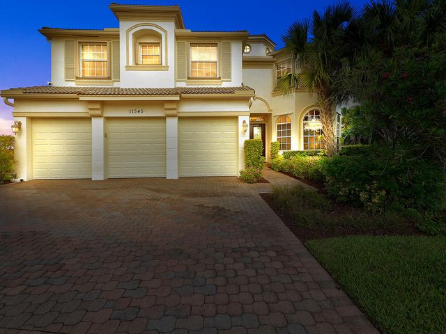 Beautiful two story home featuring 5 bedrooms + Den and 5.5 baths in TownPark at Tradition. Step in through the alluring doublefront doors to find exquisite finishes. Ceramic tile and wood flooring throughout the main living areas. The kitchen area features custom wood cabinetry, granite counter tops and backsplash, snack bar, and a breakfast area overlooking the patio/pool. The master suite features volume/tray ceilings, an enormous walk-in closet, dual sinks and a separate tub/shower. The screened patio features a stunning in ground pool with travertive deck complete with a waterfall & spa. The outdoor kitchen with BBQ area is a perfect place for entertaining friends and family. Tradition is a wonderful community minutes from great shopping, restaurants, banks, hospital, and  I-95