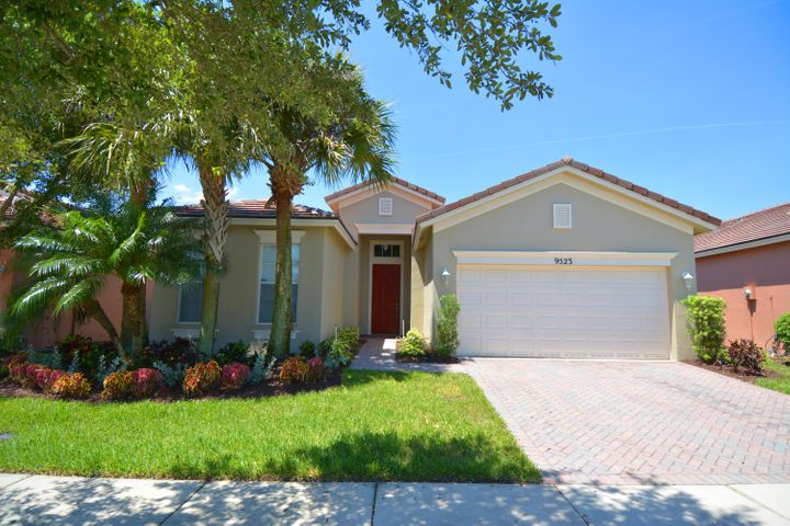 Superbly maintained home in Heritage Oaks, a gated community of Tradition in Port St Lucie Florida. Traditions is a master-planned, mixed-use community.  You will have access to shopping, a brand new Hospital, restaurants and LA Fitness to mention a few.  Green space and public lakes  are just a short stroll or bike ride away within the Tradition Community! Whether you are looking for peace and quiet or a vibrant community, you will find it here!  This home has Granite counter tops and glass backslash in the kitchen, bamboo flooring in the master bedroom.  Tile roof that has just been installed ($30k Value). A must see call NOW Before it's gone