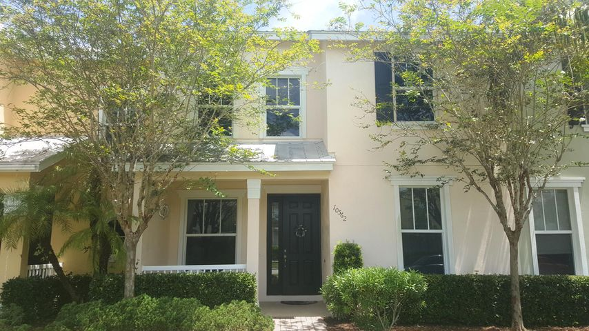 Beautiful single floor 2-bed/2-bath Townhome in Port Saint Lucie Tradition-Bedford Park, 2-car rear garage on private drive, living, dining, family, vaulted ceilings, spacious open kitchen w/granite tops, laundry room, black premium LG & Whirlpool appliances, impact windows & shutters for rear sliders, front & rear parking, covered entrance with rear lanai pavers leading to driveway. HOA dues includes cable, internet, monitoring alarm, sprinkler system, lawn care and pest control. Offers resort heated pool with many clubhouse amenities. Walking distance to the Tradition home-town lifestyle offering many fine restaurants, pubs, dental, dry cleaning, banking Publix food store, countless Mall shopping stores, premiere Hospital, pet parks, and direct I-95 access.  A must see..
