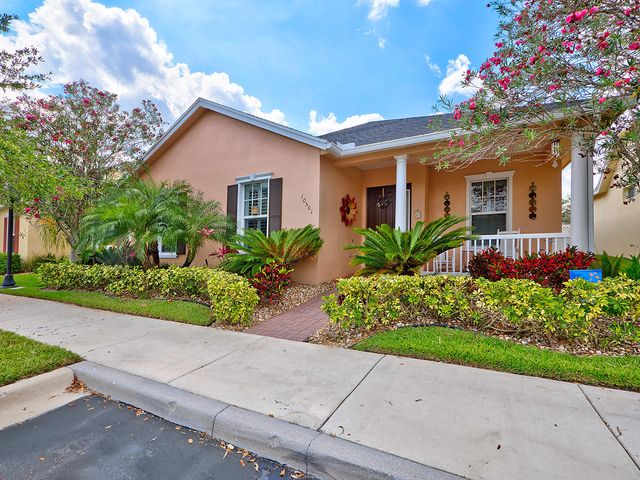 LOCATION, CONVENIENCE, AND LIFESTYLE! This beautiful Key West style features 4 bedrooms and 2.5 baths of spacious and bright living with exquisite finishes. Step through the front door to be immediately greeted with bamboo style ceramic tile flooring and crown molding in the main living areas. A cheerful kitchen features granite counter tops, stainless appliances, and a large cook island/snack bar. The master suite boasts organizers in the closets and a modern and updated bathroom complete with a Jacuzzi tub, a separate shower, and a built-in tv. The covered/screened patio overlooks a grassy yard area, which offers plenty of play space for kids! This property is within walking distance to Tradition Square, which features great dining, shopping, and easy access to I-95.